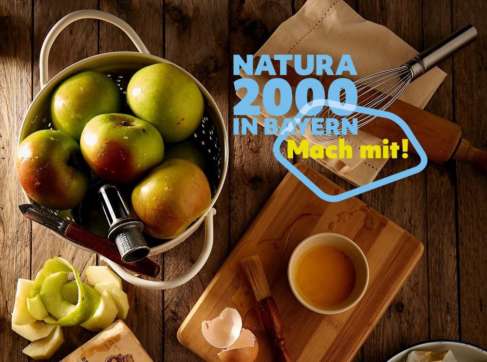 Äpfel und Backzutaten auf einem Tisch, Aufschrift: Natura 2000 in Bayern - Mach mit!